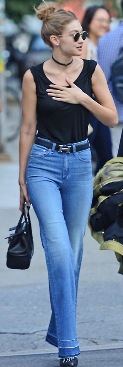 Gigi Hadid: Belt – Hermes  Necklace – Shay  Purse – Versace  Sunglasses – Ray Ban  Shoes – Stuart Weitzman