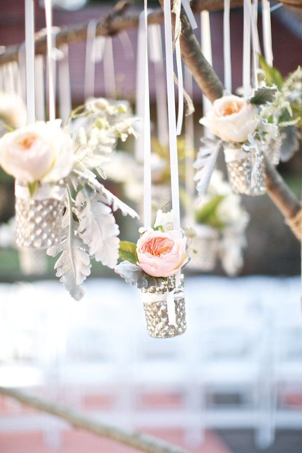 Hang floral filled votives with ribbon for chic reception decor: http://www.stylemepretty.com/collection/3684/