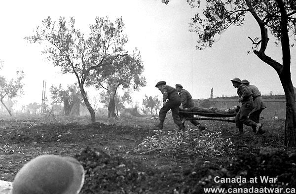 Italy (Misc.) - A Canadian Regimental Aid Party carrying a wounded soldier, Italy, October 1943.