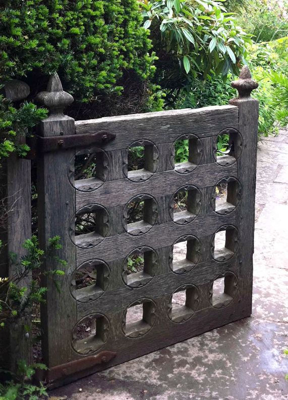 Old arts and crafts gate from gardens designed in the Arts and Crafts style by Lutyens along with Nathanial and Christopher Lloyd (father and son).