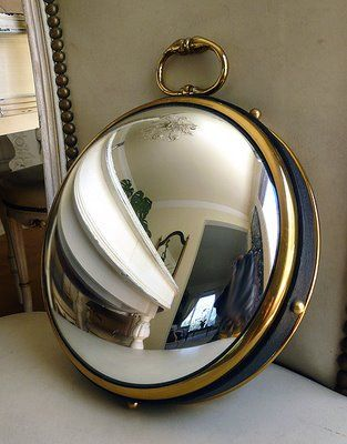 Gorgeous convex mirror that looks like a pocket watch!