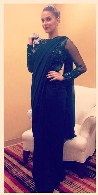 Neha Dhupia in our Black saree gown. #varunbahlcouture #nehadhupia #floral…