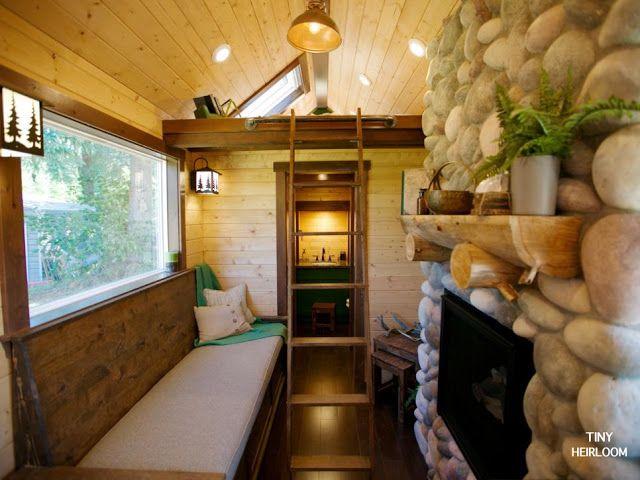 A Tiny House With A Stone Fireplace