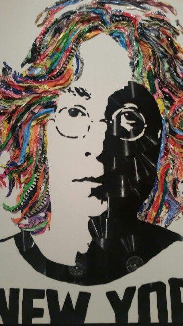 John Lennon by Mr. Brainwash.  Broken vinyl records on canvas.