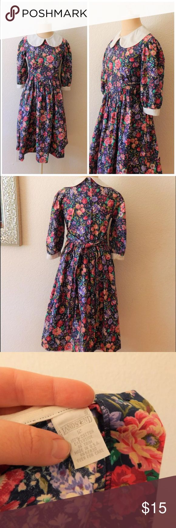 "Vintage Lands End Girls Floral Prairie Dress Vintage Lands End Girls Peter Pan Collar Floral Modest Prairie Dress  Button Back  Tie Waist 100% Cotton Made USA Machine Wash Tumble Dry Tag Size 12  -- shown on adult size 0-2   Bust circumference: 31"" Waist circumference: 33"" Hip circumference: open Length: 40"" Vintage Dresses Casual"