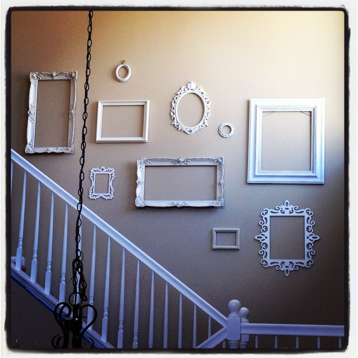 Paint different picture frames white so they coordinate. Then fill with cute pics of sisters!