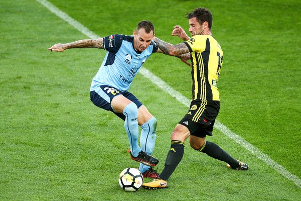 Luke Wilkshire Photos - Luke Wilkshire of Sydney FC is tackled by Tom Doyle of the Phoenix during the round 12 A-League match between the Wellington Phoenix and Sydney FC at Westpac Stadium on December 23, 2017 in Wellington, New Zealand. - A-League Rd 12 - Wellington v Sydney