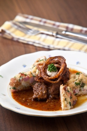 Beef goulash with crispy bacon and Carlsbad dumplings