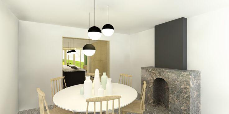 Eetkamer met marmeren haard en ronder eettafel ontworpen door De Nieuwe Context