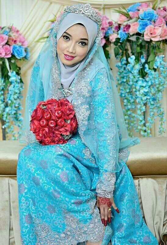 Blue songket with light purple flower design wedding outfit...this is beautiful! @weddinggaloresdnbhd