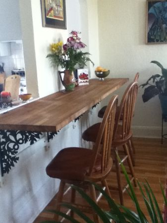 Wide Shelf With A Couple Of Bar Stools And You Have An Eating Area