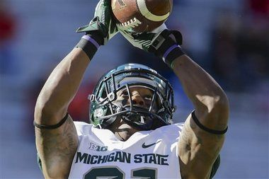 Things are looking up for Michigan State football cornerback Darqueze Dennard and the Spartans, as they moved up to No. 13 in the Associated...