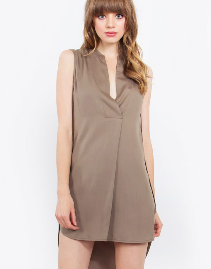 – High low shirt dress – Sleeveless – Mandarin collar – Color: Sage  Size + Fit – Model is wearing size S – Measurements taken from size S – Front Length: 35″ – Back Length: 39.375″ – Chest: 38″