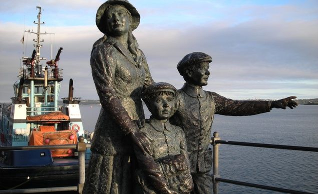 Statue outside the Cobh Heritage Center, which is dedicated to the history of Irish emigration.