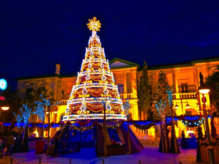 The eco-friendly Christmas tree stands in front of the district administration office in the center of the city.  This building is a beautiful example of the local architecture that traces back to traditional neoclassical Greek buildings as well as European, most notably English, influences.