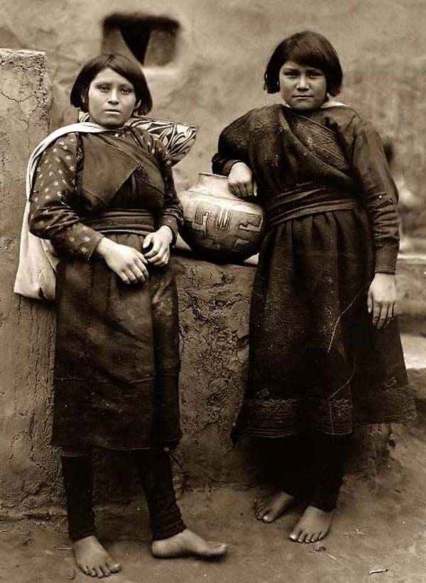 Here for your browsing pleasure is a grand photo of Two Zuni Indian Girls. It was made in 1903 by Edward S. Curtis.    The photo documents Two Zuni girls standing in front of a pueblo building.    We have compiled this collection of photos mainly to serve as a vital educational resource. Contact curator@old-picture.com.    Image ID# 548D481EGirls Indiansofamerica, Edward Curtis, Girls Generation, American Indian, Girls Stands, Zuni Indian, Zuni Girls, Indian Girls, Native American