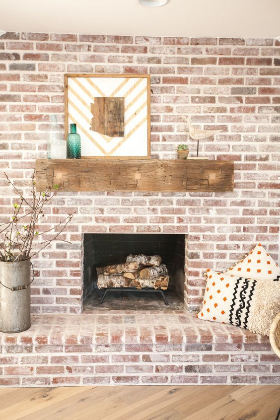 Brick fireplace with antique beam mantel eclecticallyvintage.com