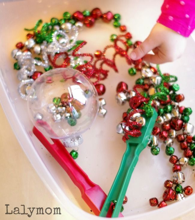 Jingle Bells Christmas Sensory Bin for Kids - Perfect to explore magnets at Christmas time and to explore music as well as syllable break down!