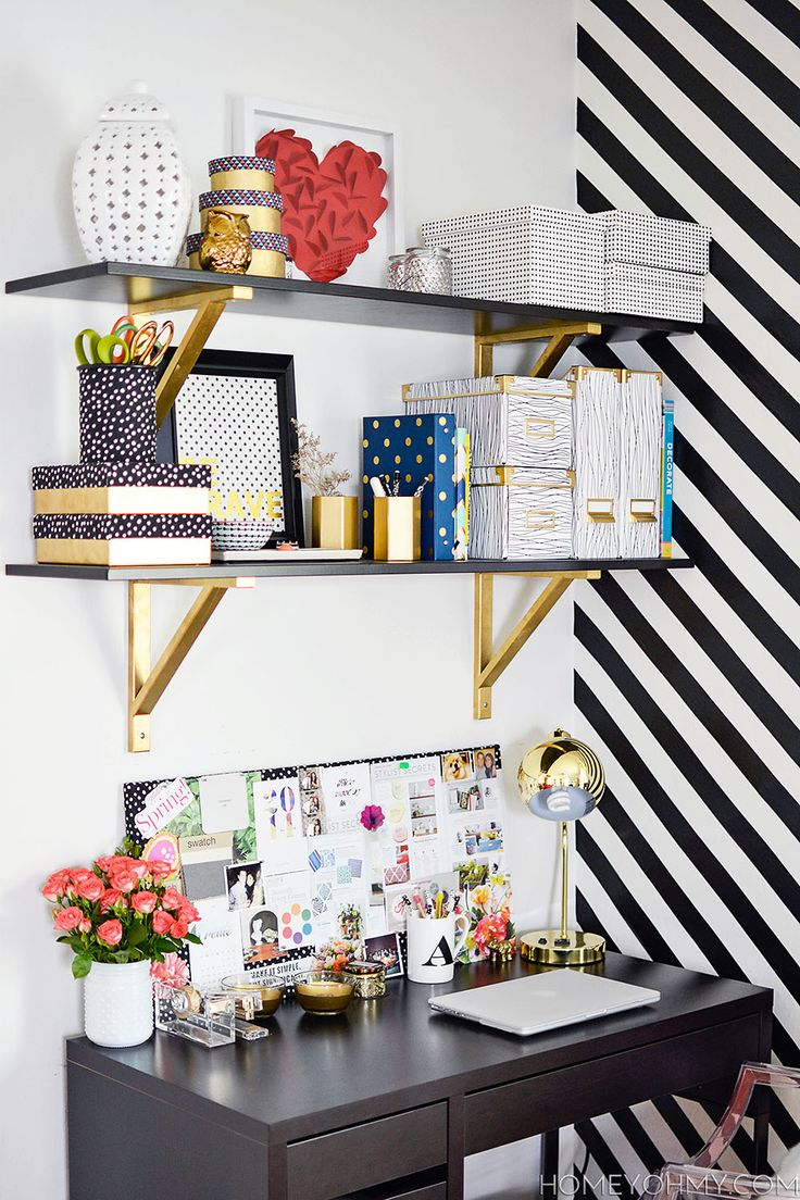 Install shelves above a desk to make the most of a small work space.