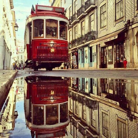 Lisbon Red Tram - vintage living through a moder city #Portugal