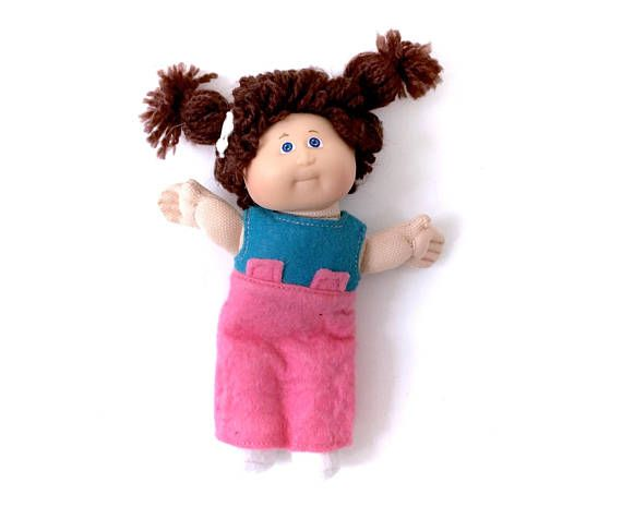 Vintage 80s Cabbage Patch Kids Small Doll Brown Hair Pigtails! Follow Me & Use The Coupon Code PINTEREST For 10% Off Your ENTIRE Order! Dozens of G1 My Little Ponies, Polly Pockets, Popples, Strawberry Shortcake, Care Bears, Rainbow Brite, Moondreamers, Keypers, Disney, Fisher Price, MOTU, She-Ra Cabbage Patch Kids, Dolls, Blues Clus, Barney, Teletubbies, ET, Barbie, Sanrio, Muppets, Sesame Street, & Fairy Kei!