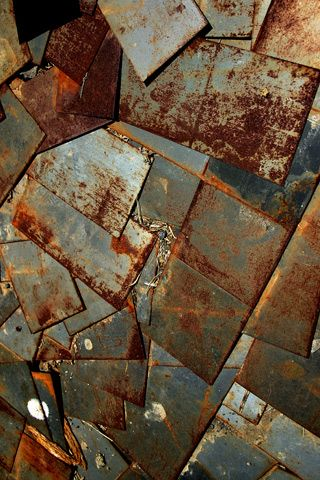 Metal has the most interaction with the physical world and shows the wear and tear with oxidation and rust.