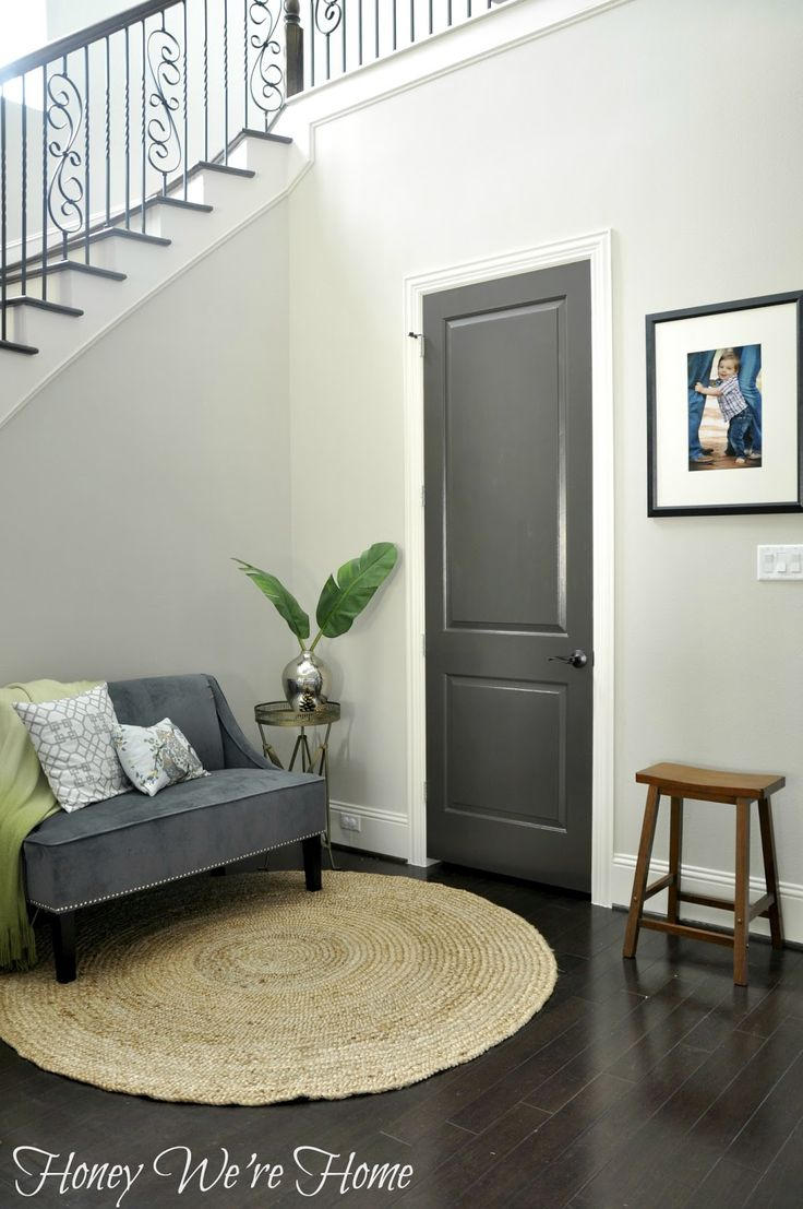 painting an interior door black or dark gray. Love how this came out there are great before and after pictures. from Honey, We're Home