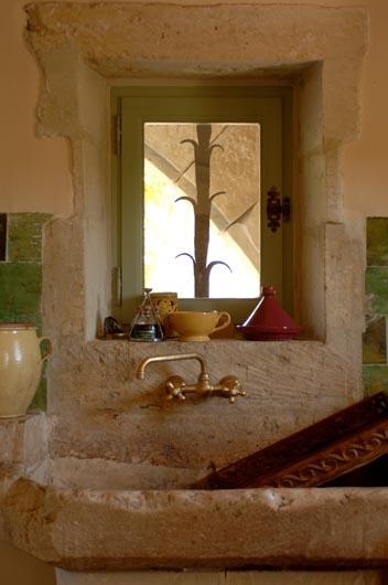green wheat window, kitchen, stone, brass sink. Alpes de Haute Provence