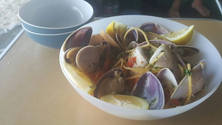 We collected our own pippies in the surf and cooked them for lunch. Pippies with Pasta in a White Wine Sauce. Recipe  Campingwithacocktail.com #pippies #campingfoodie # seafood #pasta #beachcamping
