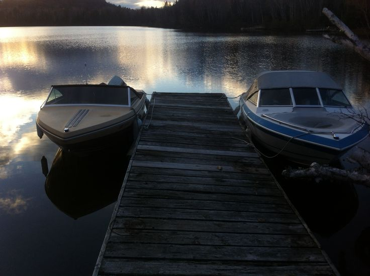 Boats on the lake in muskoka.! Summer evening reflections.!! Photo by Kyal Stephen Smith. Dorset Ontario Canada.!Taken with IPhone 4.