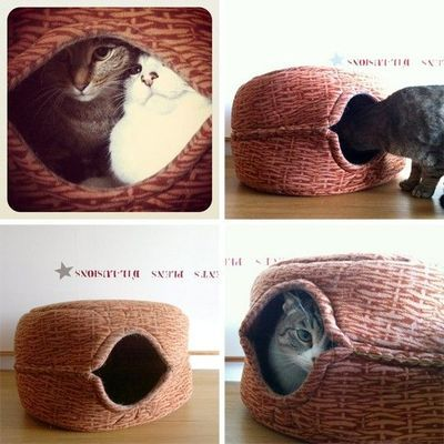DIY cat hideaway bed made from IKEA toy baskets.