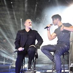 Pablo Alboran and Miguel Bose perform during a concert in Madrid