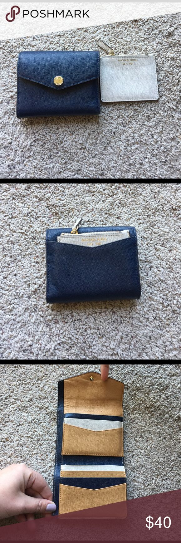 Michael Kors navy, white and tan wallet! Almost new Michael Kors wallet + coin purse! This wallet is seriously so cute. It is a deep navy blue and the inside has a tri-color card holding area. Michael Kors Bags Wallets
