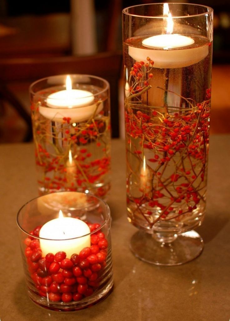 Ideas para decorar tus velas navideñas - velas flotantes con ramitas de frutos