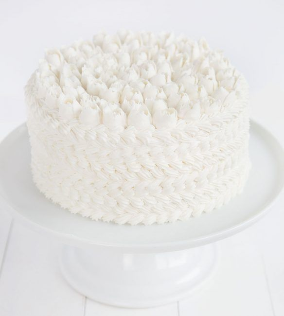 WASC {white chocolate sour cream almond} Cake covered in white buttercream with a russian tip roses on top! - I am baker
