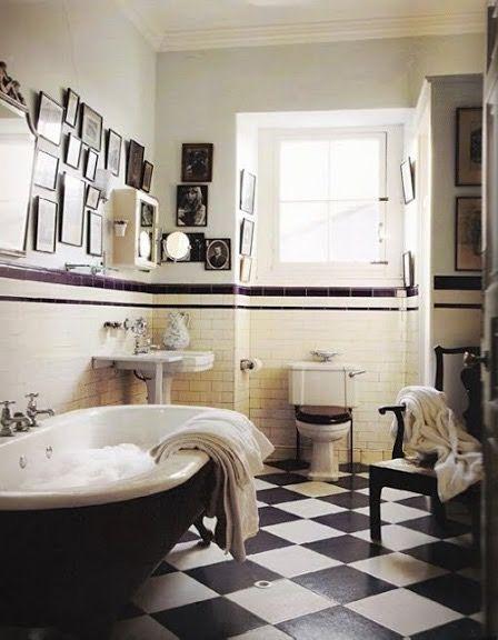 Old tiled ivy league-ish bathroom. Black toilet seat on white toilet.