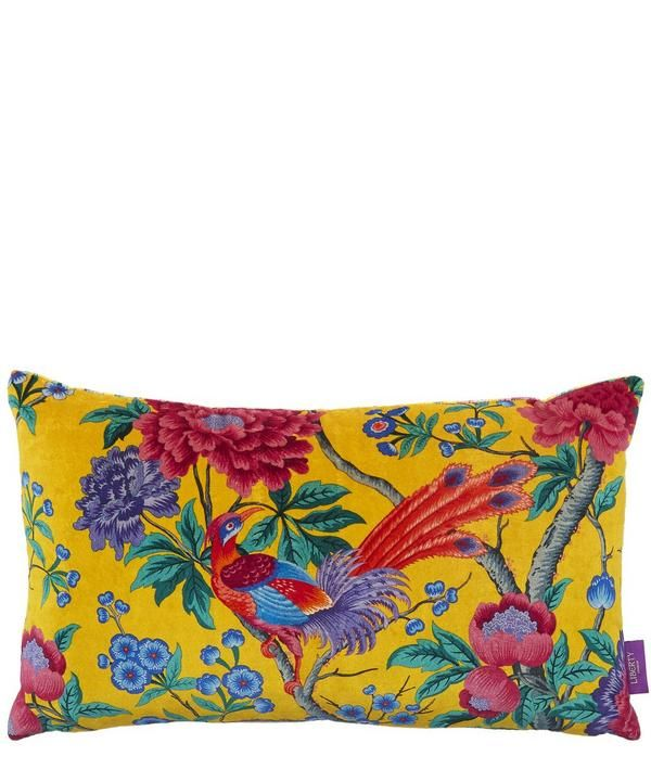 The Liberty London Elysian Paradise printed velvet bolster cushion adds a decadently soft accent to home interiors.