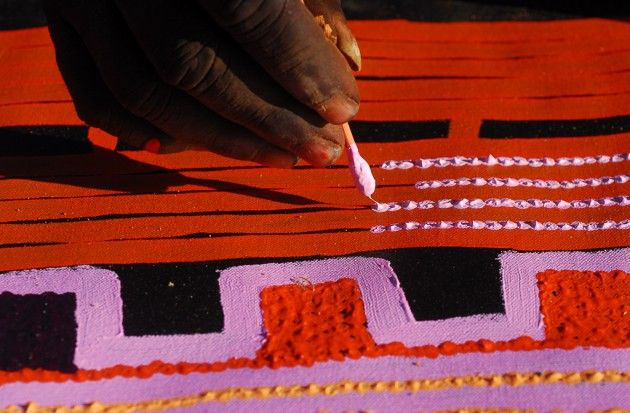 Papunya Tula artist Patrick Tjungurrayi paints Canning Stock Route Country.