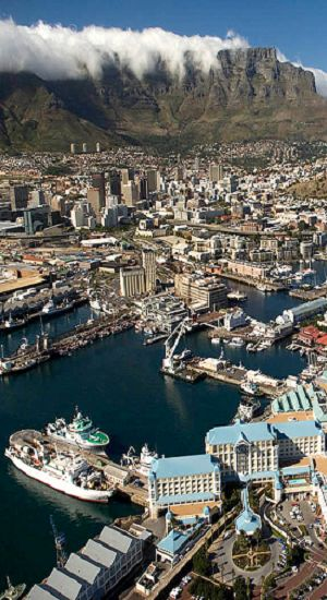 Waterfront - Cape Town, South Africa, with nature's spectacle of clouds crossing the summit of Table Mountain and pouring down into the valley.