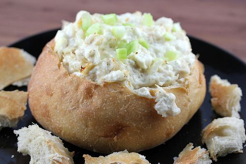 Hot Crab Dip-crabmeat, cream cheese, minced onion, mayonnaise, garlic powder, salt and pepper. Combine and bake for 20 mins. in baking dish then serve, or if you plan to use a bread bowl now spoon hot mixture in bread bowl and heat 10 more mins. Can be served with crackers or bread pieces.
