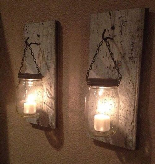 Hang mason jars on hooks mounted to old boards for rustic sconces. Really simple and cute, I'd paint the jars tho maybe add glitter!