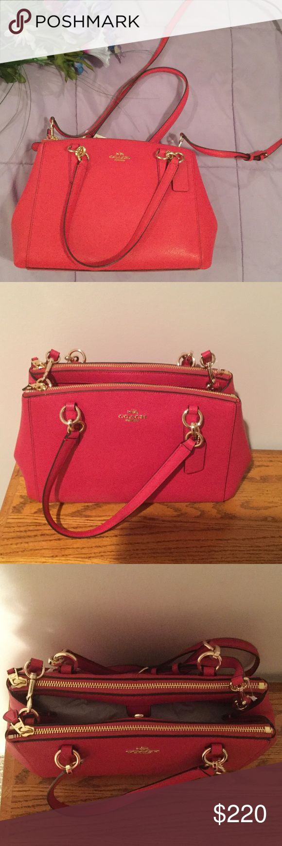 NWT Pink Coach Purse Gorgeous authentic bright pink Christie purse from coach. Has 3 compartments, the two outer compartments zip while the middle compartment has a clasp. Coach Bags