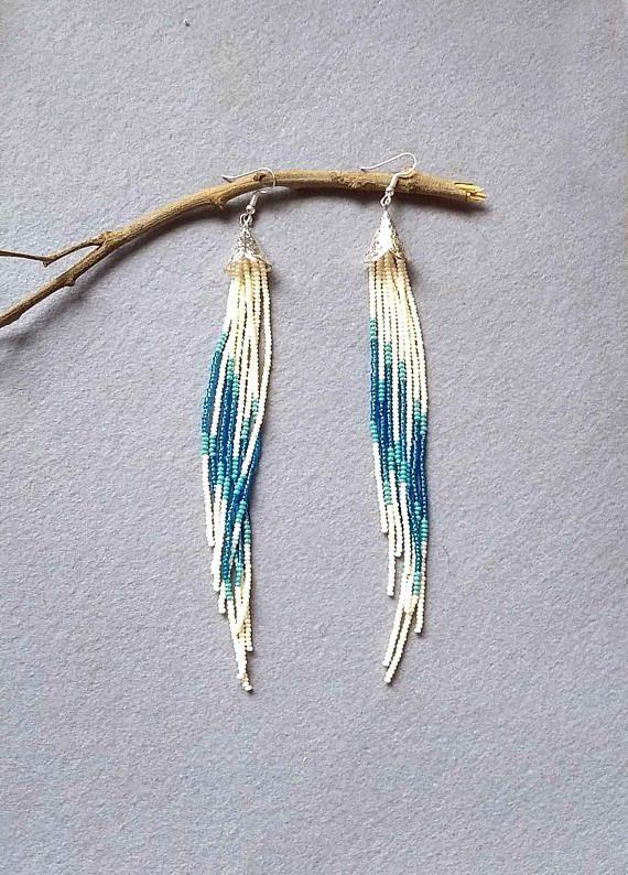 Long tassel earrings https://www.etsy.com/in-en/listing/527638154/long-tassel-earrings-shoulder-duster