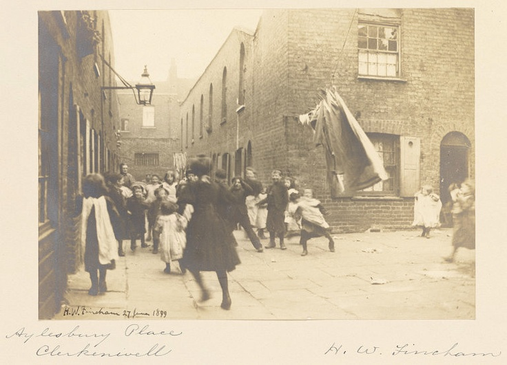 Children playing in a London slum (present day Clerkenwell), 1899. Photograph by Mr. Henry Walter Fincham.