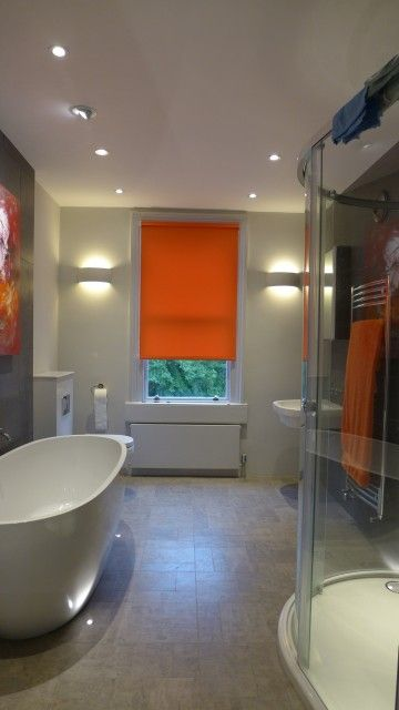 flexible bathroom lighting - recessed LED downlighters, wall lights, floor lights to illuminate bath, and wall washer to highlight painting