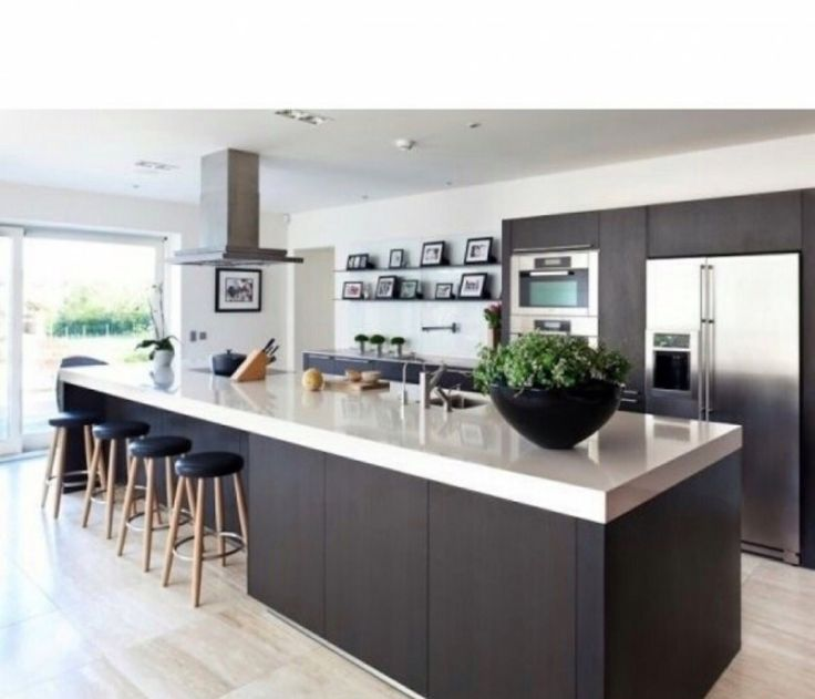Another nice kitchen - contemporary but the contrasting wood effect/white gloss takes the edge off (although perhaps too dark for us?). Like the barstools along the island but we probably need to space them out along the length to give the kids sufficient space...