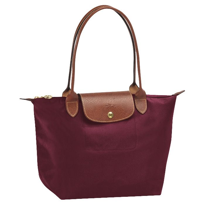 Long Champ Le Pliage- my next color or in the pink. I thought I wanted red but I want a different kind of red bag next.