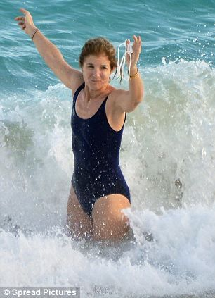 Caroline Kennedy catches a wave with her husband of some 25 years American designer Edwin Schlossberg