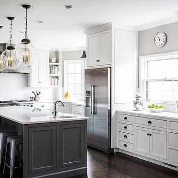 Charming White And Gray Kitchen Features White Cabinets Adorned With Bronze Cup  Pulls And Knobs Paired With White Quartz Countertops And A White Subway  Tile ... Part 26