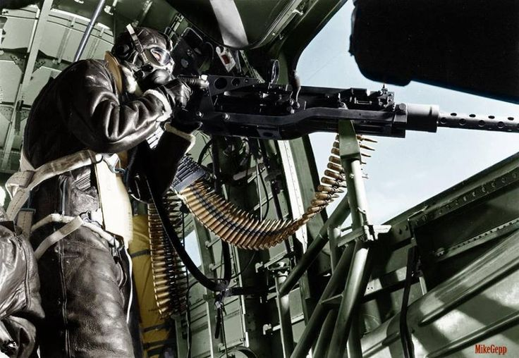 Picture of B17 waist gunner with his 50cal. machine gun, 1943. at Earth66.com